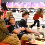 Senior Chase Tetrick chats with one of his teammates before taking his turn to bowl. Photo by Grace Goldman