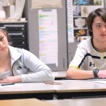 Juniors Whitney Peterson and Zach Krause finish taking notes in their graphic design class. Photo by Morgan Plunkett