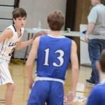 Freshman Luke Hanson looks for an open teammate. Photo by CJ Manne