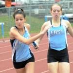 Sophomore Kara McCaskey hands off the baton to her teammate Lucy Hoffman in their 4x800 meter race. Photo by Luke Hoffman