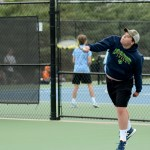 Junior Jacob Roberts serves an ace to his opponent in his team's first set of the match. Photo by Luke Hoffman