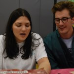 Seniors Stella Kirkman and Lars Troutwine collect donations at a booth of the cabaret. Photo by Diana Percy