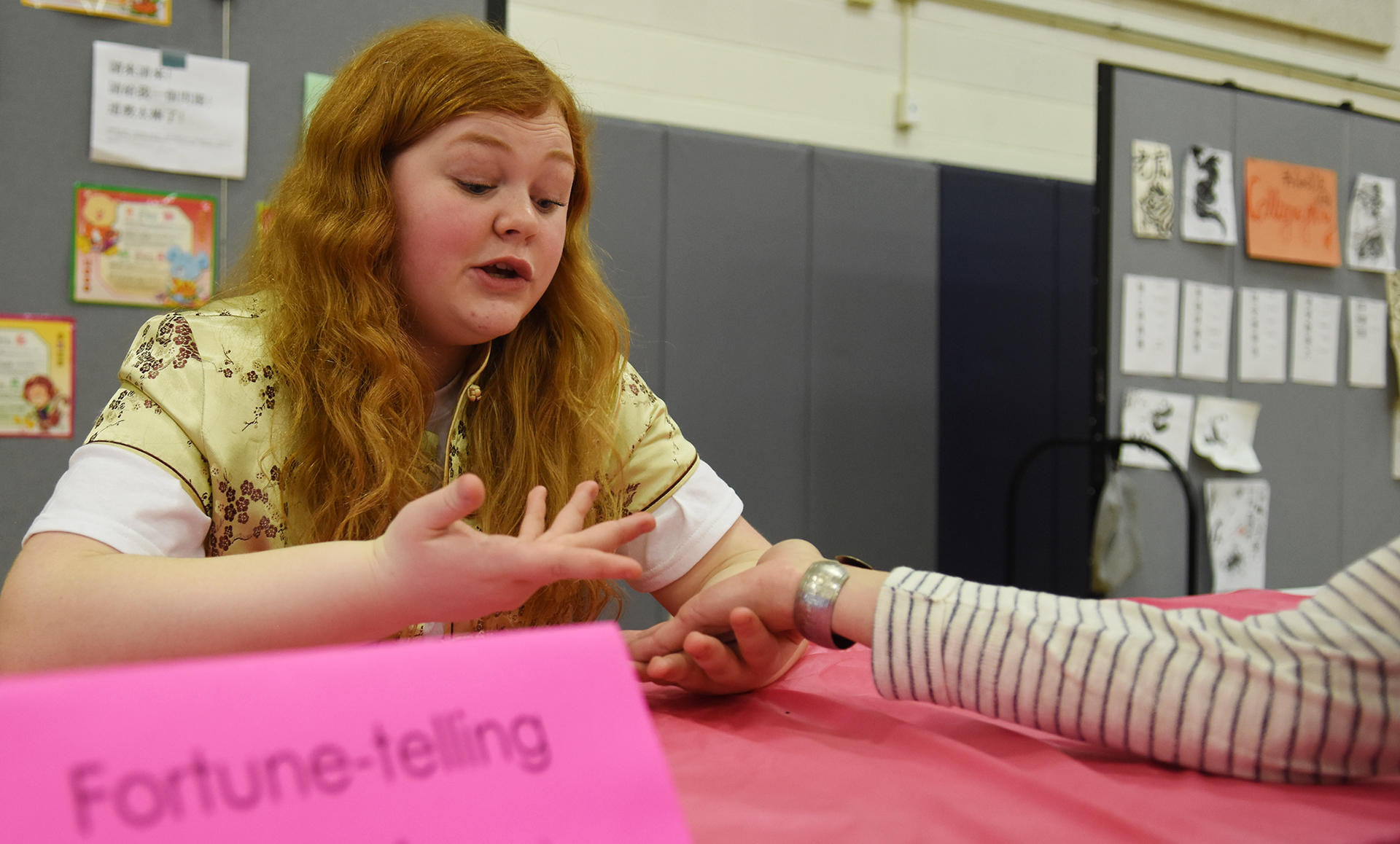 Senior Carson Camp tells fortunes to visitors of the Cabaret. Photo by Diana Percy