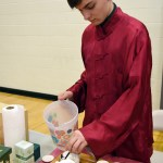 Junior Mathew Trecek runs the tea booth, pouring different types of teas for attendees to try. Photo by Diana Percy