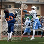 Senior William Larson pressures the other team's goalie after a stopped shot. Photo by Diana Percy