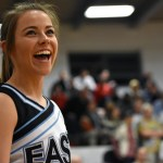 Before calling the chant, senior cheer captain Tyler Lockton laughs with her teammates. Photo by Lucy Morantz