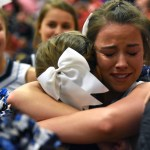 After the final buzzer, senior Tyler Lockton hugs sophomore cheerleader Maggie Gray in their last game cheering together. Photo by Lucy Morantz