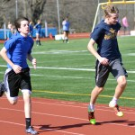 Freshman Wyatt Pearlman practives sprints with his teammate freshman Brian Woods. Photo by Katherine McGinness