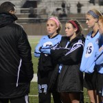Coach Kelly talks to senior Libby Legard, senior Tyler Lockton, junior Maddy Muther, and freshman Emma Burden after substituting them out of the game. Photo by Ellen Swanson