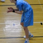Junior Jack Schoemann claps after he makes a 3-point shot. Photo by Izzy Zanone