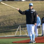 Head Coach, Jerrod Ryherd, motions with the bat to direct players on the field. Photo by Kaitlyn Stratman