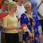 Frehsman Gillian Royster and senior Sarah Milgrim sing a traditional Chinese song at the end of the event. Photo by Morgan Plunkett
