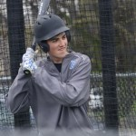 Sophomore Jack Gilman practices his batting in the batting cages with his team mates. Photo by Morgan Plunkett
