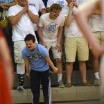 As the Lancers get ready to play offense, sophomore Jack Melvin screams in excitement, backed by the rest of the student section. Photo by Celia Hack