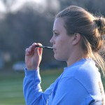 JV soccer coach Emily Flet watches the scrimmage with anticipation. Photo by Reilly Moreland