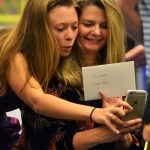 After the players presented their letters to their parents, senior Josie Clough takes a selfie with her mom. Photo by Sophie Storbeck