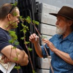 A gardener tries to sell a fair-goer seeds of the plant they stand near. Photo by Diana Percy