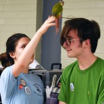 Sophomore Natalie Nitsch helps remove a parrot from junior Alex White's head. Photo by Diana Percy