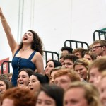 Senior Lauren Cole stands up above the crowd and cheers on her classmate and friend, Jacob DeSett, in musical chairs. Photo by Diana Percy