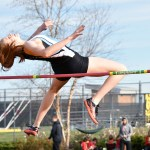 Junior Jessie Stindt tries to jump her personal high jump record at 5 feet 5 inches tall. Photo by Laini Reynolds