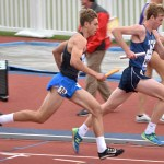 Senior Grant Roesner runs the 400 meter dash in the distance medley relay. Photo by Laini Reynolds