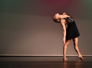 Senior Annie Smith holds a pose during her senior solo performance. Photo by Lucy Morantz