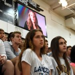 Juniors Sam Letche, Carter Kirkland, Faith Nicholson, Kendall DeCoursey, and Mia Justice intently watch the anti-bullying video during the performance. Photo by Ellie Thoma