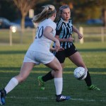 Senior Bria Foley chases the ball to gain possession before her defender. Photo by Ellen Swanson