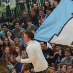 Senior Jake Randa leads the other flags at the beginning of the assembly. Photo by Ty Browning