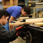 Before getting to work, senior Tony Salinas and freshman Daniel Adel set up their station. Photo by Grace Goldman