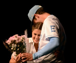 Following senior Hayley Bell's solo performance, she hugs senior Henry Miller after he surprised her with flowers and asked her to prom. Photo by Allison Stockwell