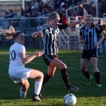 Junior Maddy Muther keeps possession of the ball while blocking her opponent. Photo by Katherine Odell