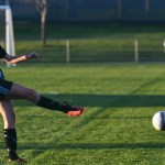 Senior Porter Carroll kicks the ball to one of her teammates during the game. Photo by Reilly Moreland