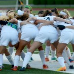 The girls varsity soccer team huddles up before the beginning of the game. Photo by Luke Hoffman