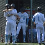 Seniors Luke Anderson and Clayton Phillips hug as Phillips returns to the dugout after his home run.