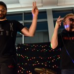 Teacher David Muhammad and senior Deegan Poores hold up two fingers to represent lyrics in the original song they performed together. Photo by Lucy Morantz