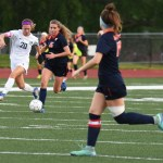 Senior Josie Clough attempts to steal ball from Olathe East defender. Photo by Carson Holtgraves