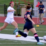 Senior Jessica Parker races towards the ball to steal it back from the opposing team. Photo by Izzy Zanone