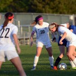 Senior Josie Clough tries to guard the opponent and get possession of the soccer ball. Photo by Katherine Odell