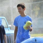 Sophomore Sam Vaugn holds a sponge to wash a car. Photo by Ally Griffith