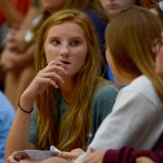 Sophomore Katie Aliber listens to her friend during her coach's presentation. Photo by Luke Hoffman