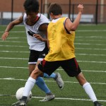 Sophomore Moses Daung gets blocked by Freshman Noah Brende while trying to score a goal. Photo by Carson Holtgraves