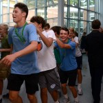 As the conga line laps around the cafeteria, freshman Jack Lynch laughed with the onlookers. Photo by Ellie Thoma