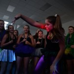 Freshman Megan Biles shows off her moves for the crowd forming around her in the center of the dance. Photo by Ellie Thoma