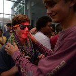 Freshman Clay Faught helps freshman Graham McMonigal fit as many beads around his neck as he can. Photo by Ellie Thoma