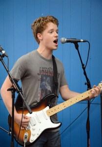 Senior Sam Fay sings and plays guitar. Photo by Katherine McGinness