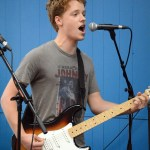 Senior Sam Fay sings and plays guitar. Photo by Katherine McGinness