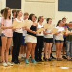 The chamber choir, directed by Mr. Foley, performs a new song. Photo by Ellen Swanson