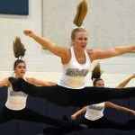 Junior Hannah Goettcsh jumps into a toe touch position during the varsity lancer dancer team dance. Photo by Katherine Odell