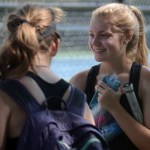 Sophomore Jackie Cameron talks with her friends in between matches. Photo by Kate Nixon